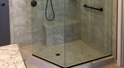 Our team installs fixed panel showers with a gap that serves as an entry into the shower enclosure, like the one pictured here.