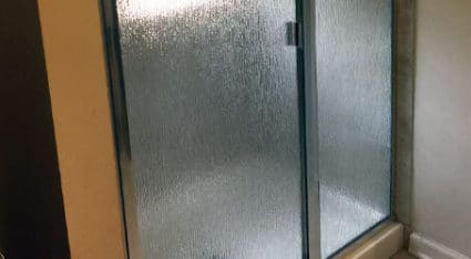 We install framed shower doors in a wide variety of styles, including this frosted glass pane look.