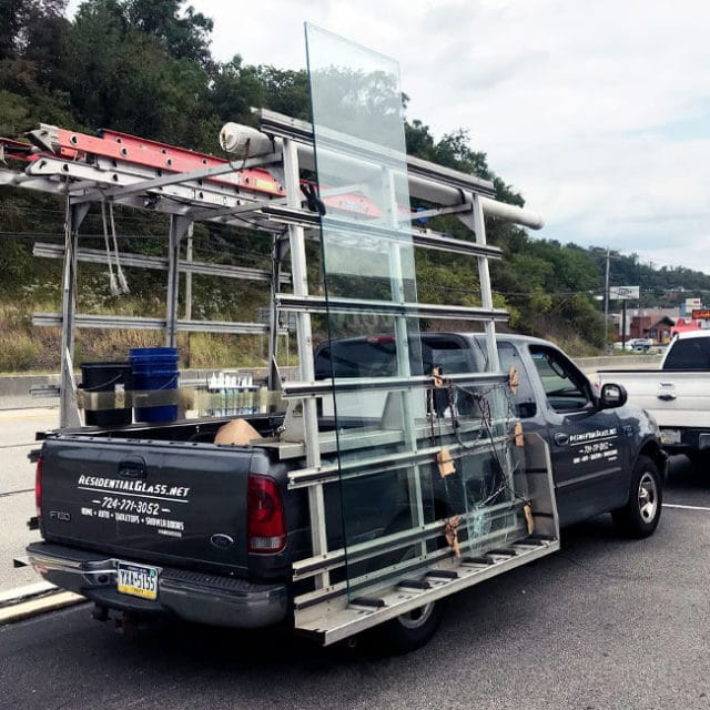 One of our trucks carefully transports a new pane of glass to a local home here in Pittsburgh.