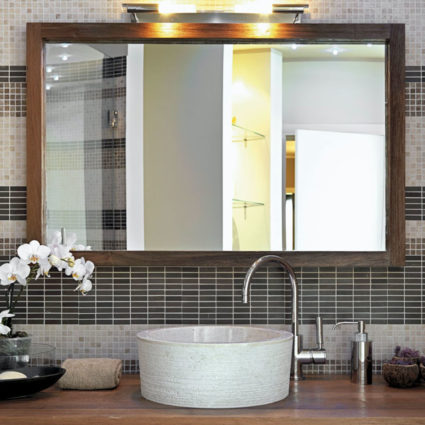 Remodeling your bathroom? Give us a call and have us install a stylish new mirror, like the one seen here.